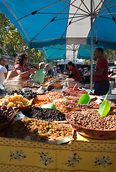 Nuts, raisins, candied fruits, and home-cured olives tempt, nicely displayed on Provencal-style cloth. Thursdays are market day in this interesting small town across the Rhone River from Avignon.  Easily accessed by city bus, the market offers the freshest of locally grown foods, along with a wide variety of crafts and clothing, a good stop for regional souvenirs.