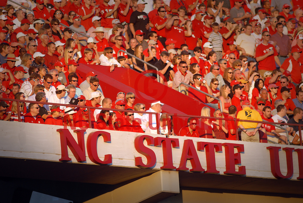 Fans watch the Wolfpack play against USC.