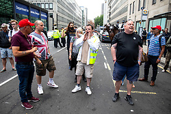 © Licensed to London News Pictures. 03/06/2019. London, UK. Pro-Trump supporters chant outside Westminster Abbey, as the President of the United States Donald Trump (not pictured) arrives at Westminster Abbey to lay a wreath at the Tomb of the Unknown Warrior. Photo credit : Tom Nicholson/LNP