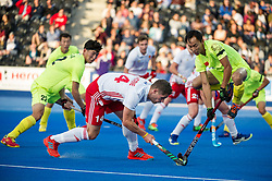 China's Wei Wo takes invasive action from Mark Gleghorne of England. England v China - Hockey World League Semi Final, Lee Valley Hockey and Tennis Centre, London, United Kingdom on 15 June 2017. Photo: Simon Parker