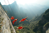 Dancers Hang On Cliff To Perform