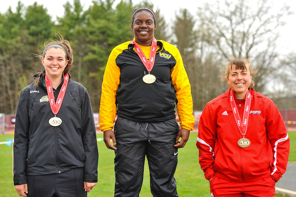 AMHERST, MA - MAY 4: Jaleesa Williams of Virginia Commonwealth University (522) stands atop the podium after winning the women's discus during Day 2 of the Atlantic 10 Outdoor Track and Field Championships at the University of Massachusetts Amherst Track and Field Complex on May 4, 2014 in Amherst, Massachusetts. Michelle Wallerstedt, left, of George Mason was second, and Ashley Adams, right, of Duquesne was third. (Photo by Daniel Petty/Atlantic 10)