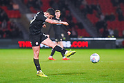 Alex Mowatt of Barnsley (27) shoots during the EFL Sky Bet League 1 match between Doncaster Rovers and Barnsley at the Keepmoat Stadium, Doncaster, England on 15 March 2019.