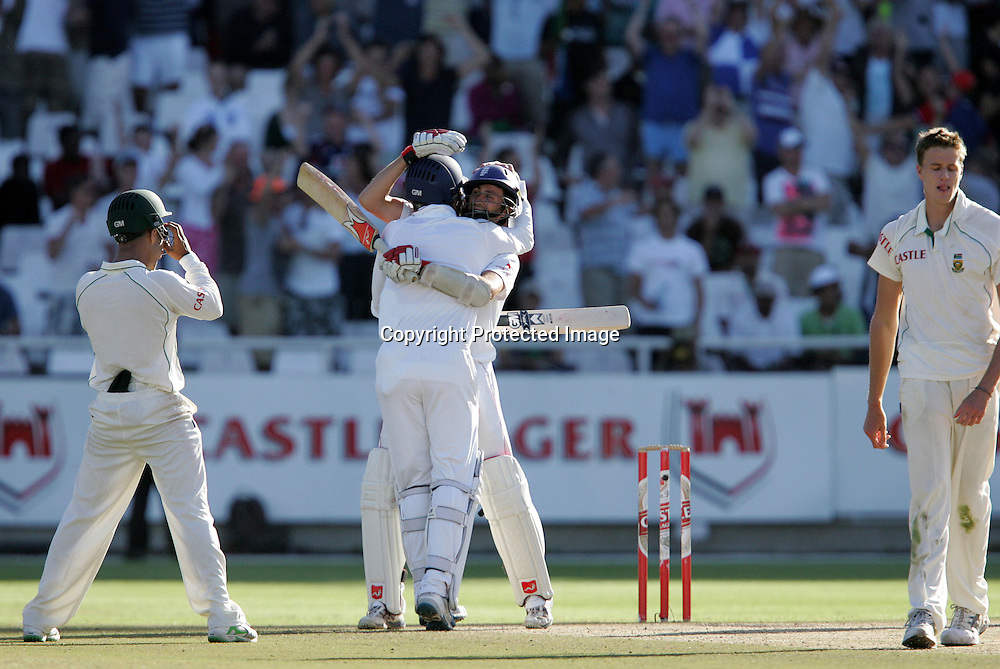 Graham Onions and Graeme Swann celebrate holding on to tie the test and make the series impossible to lose as a dejected Morne Morkel and Jean Paul (JP) Duminy look on during the 5th day of the third test match between South Africa and England held at Newlands Cricket Ground in Cape Town on the 7h January 2010.Photo by: Ron Gaunt/ SPORTZPICS