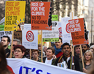Demonstrators march during the Time To Act, National Climate March organised by Campaign Against Climate Change in London, England on March 7, 2015