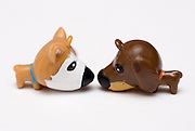 Puppy Love - Front Sniff a conceptual image of two toy dogs in an intimate relationship