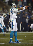 Carolina Panthers quarterback Cam Newton (1) points from the shotgun formation during the NFL week 19 NFC Divisional Playoff football game against the Seattle Seahawks on Saturday, Jan. 10, 2015 in Seattle. The Seahawks won the game 31-17. ©Paul Anthony Spinelli
