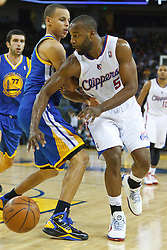 October 29, 2010; Oakland, CA, USA;  Los Angeles Clippers point guard Baron Davis (5) is guarded by Golden State Warriors point guard Stephen Curry (30) during the second quarter at Oracle Arena.
