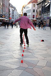 A nimble skater entertains for tips on the Stroget, Copenhagen's pedestrians-only shopping street in the heart of town.