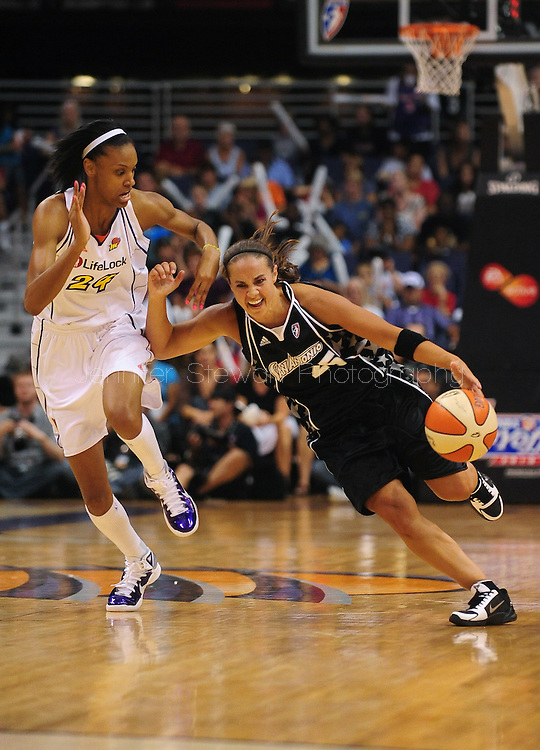 Aug 26, 2010; Phoenix, AZ, USA; San Antonio Silver Stars handles the ball along side Phoenix Mercury guard DeWanna Bonner (24) during the second half in game one of the western conference semi-finals in the 2010 WNBA Playoffs at US Airways Center.  The Mercury defeated the Silver Stars 106-93.  Mandatory Credit: Jennifer Stewart-US PRESSWIRE