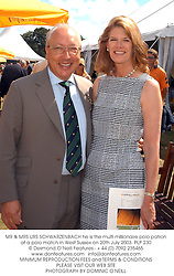 MR & MRS URS SCHWARZENBACH he is the multi millionaire polo patron at a polo match in West Sussex on 20th July 2003.PLP 230