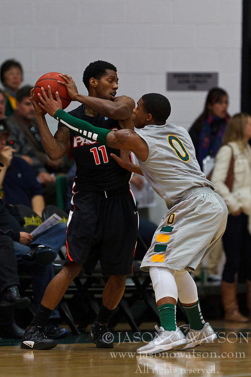 Dec 10, 2011; San Francisco CA, USA;  Pacific Tigers guard Lorenzo McCloud (11) is defended by San Francisco Dons guard Dominique O'Connor (0) during the first half at War Memorial Gym.  Mandatory Credit: Jason O. Watson-US PRESSWIRE