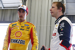 July 13, 2018 - Sparta, Kentucky, United States of America - Joey Logano (22) and Brad Keselowski (2) hang out in the garage during practice for the Quaker State 400 at Kentucky Speedway in Sparta, Kentucky. (Credit Image: © Chris Owens Asp Inc/ASP via ZUMA Wire)