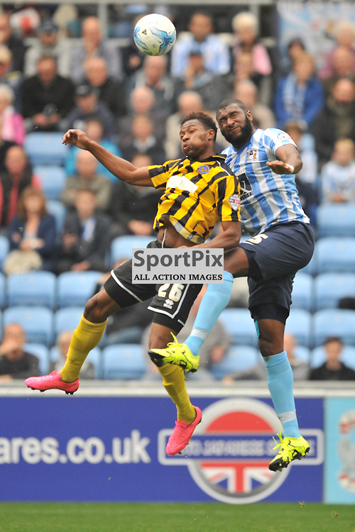 Coventrys Reda Johnson Battles with Shrewsburys John Louis Akpa Akpro,  Coventry City v Shreswsbury Ricoh Arena, Football League One, Saturday 3rd October 2015