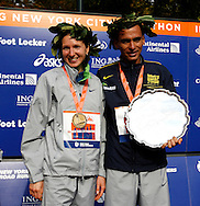 Jelena Prokopcuka, of Latvia, and Marilson Gomes dos Santos, of Brazil, pose with for photographers after receiving finishing in first place in the 2006 New York City Marathon Sunday 05 November 2006<br />