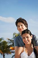 Teenage couple (16-17) on beach portrait
