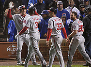 October 11, 2017 - Chicago, IL, USA - The Washington Nationals' Michael Taylor (3) is congratulated on his grand slam in the eighth inning of Game 4 of the National League Division Series at Wrigley Field in Chicago on Wednesday, Oct. 11, 2017. The Nationals won, 5-0, to force a decisive fifth game. (Credit Image: © John J. Kim/TNS via ZUMA Wire)