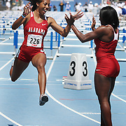 DRAKE RELAYS 2011 - Alabama's Talaya Owens leaps for joy while high-fiving teammate Audra Frimpong after anchoring the winning shuttle hurdle relay in the University Women's division.  photo by David Peterson
