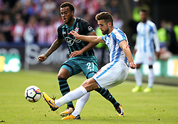 Tommy Smith of Huddersfield Town clears the ball under pressure from Ryan Bertrand of Southampton - Mandatory by-line: Matt McNulty/JMP - 26/08/2017 - FOOTBALL - The John Smith's Stadium - Huddersfield, England - Huddersfield Town v Southampton - Premier League