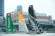 Emirates Team New Zealand, SAP and Groupama line up in practice races for the first of the Extreme Sailing Series regattas being sailed in Singapore. 19/2/2014