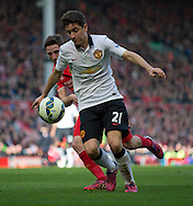 Ander Herrera of Manchester United is tracked into the box by Joe Allen of Liverpool during the Barclays Premier League match at Anfield, Liverpool<br /> Picture by Russell Hart/Focus Images Ltd 07791 688 420<br /> 22/03/2015