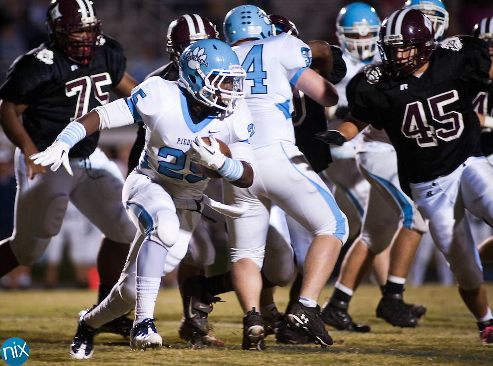 Piedmont's Darien Williams carries the ball against Jay M. Robinson Monday night in Concord. The game was originally set for Sept. 2, but was postponed due to weather. (Photo by James Nix)