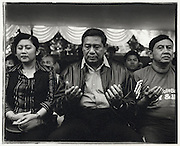 Soon to be President of Indonesia Susilio Bambang Yudhoyono with wife Kristiani Herwati and supporters pray during Indonesia's Independence Day celebrations- Jakarta Indonesia August 17 2004