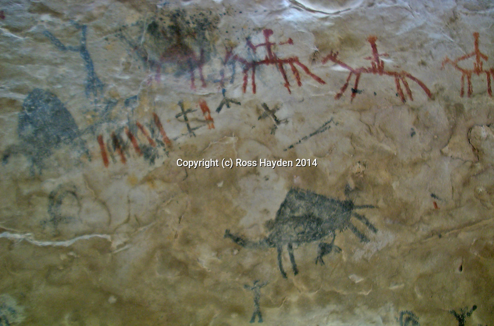 Cave painting of horses and riders with tally marks on cave wall, Wadi Raqha, Dhofar, Oman