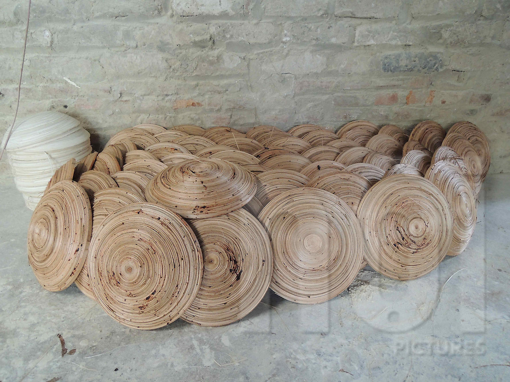 Stacked bamboo bowls left in a workshop in Cat Dang village, Vietnam, Southeast Asia