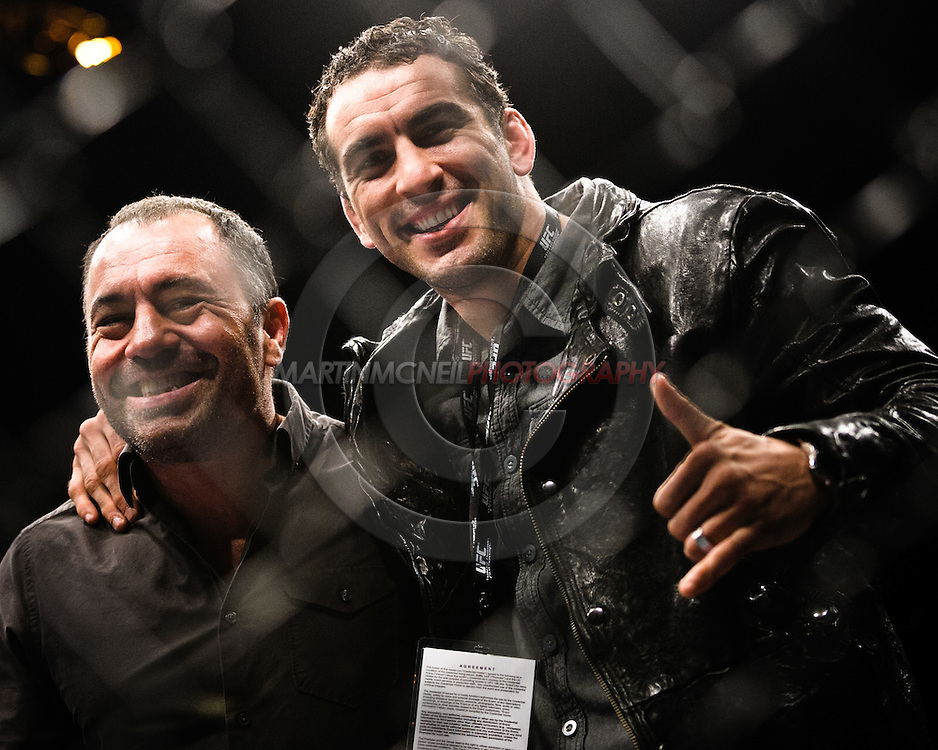 "BIRMINGHAM, ENGLAND, NOVEMBER 5, 2012: Braulio Estima (right) poses for a photograph with Joe Rogan during ""UFC 138: Munoz vs. Leben"" inside the National Indoor Arena in Birmingham, United Kingdom"