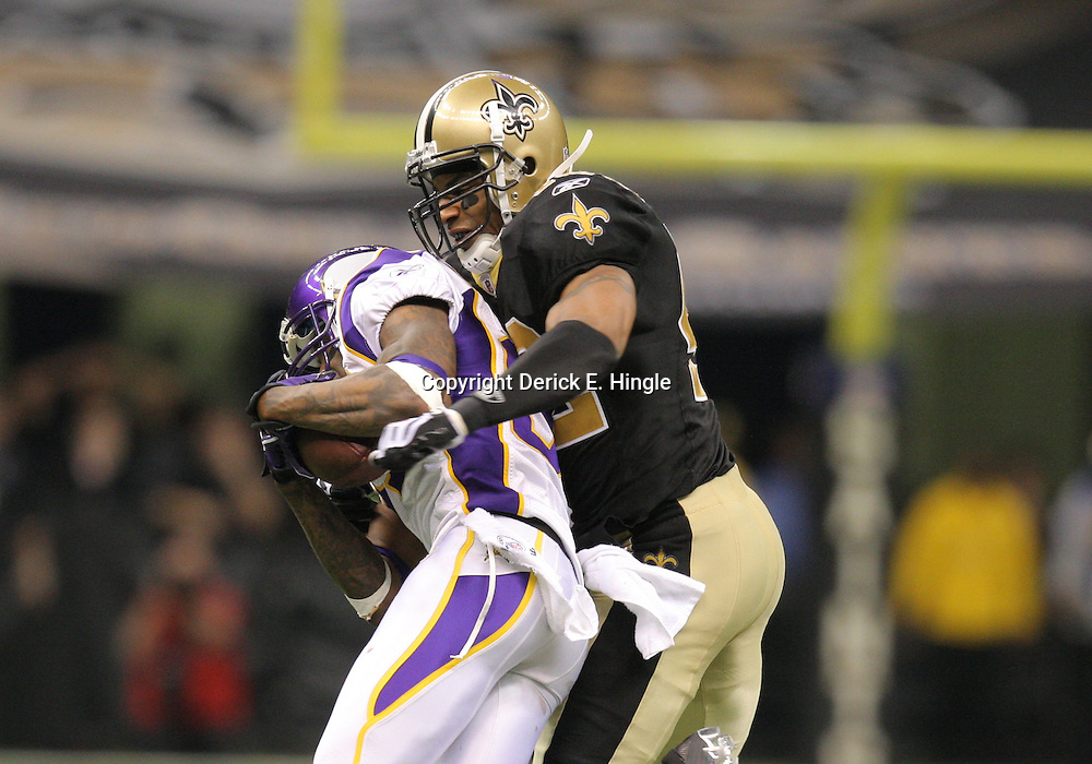 Jan 24, 2010; New Orleans, LA, USA; New Orleans Saints safety Darren Sharper (42) tackles Minnesota Vikings wide receiver Bernard Berrian (87) during a 31-28 overtime victory by the New Orleans Saints over the Minnesota Vikings in the 2010 NFC Championship game at the Louisiana Superdome. Mandatory Credit: Derick E. Hingle-US PRESSWIRE