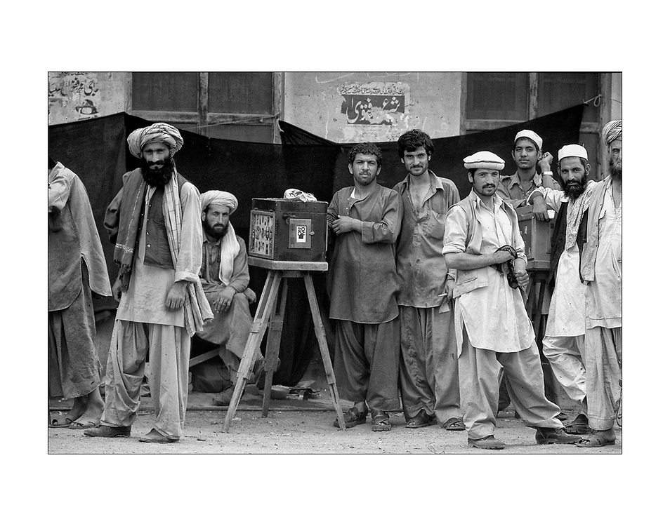 Street photographers and their subjects in Peshawar, Pakistan 1983. 2001&copy;Ed Hille/Picturedesk.net<br /> ONE TIME USE ONLY
