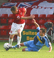 Photo: Dave Linney.<br />Walsall v Wycombe Wanderers. Coca Cola League 2. 14/10/2006.Wycombe's (R) slides in on  Mark Kinsella