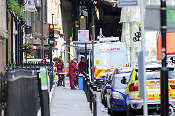 © Licensed to London News Pictures. 04/06/2017. London, UK. Forensic staff are seen close to Borough Market.  Police cordons continue to be in place around London Bridge after the previous night's terrorist attack where a reported three attackers were shot by the police and seven members of the public died after being attacked with knives.  Photo credit : Stephen Chung/LNP