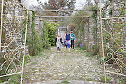 Running in the rose arbour at Pickwell Manor, Milly-grace (8), Liza Baker (9), Zac Baker (11). Pickwell Manor, Georgeham, North Devon, UK.<br /> CREDIT: Vanessa Berberian for The Wall Street Journal<br /> HOUSESHARE
