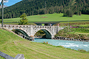 Stone bridge over the Inn River at S-chanf is a municipality in the Maloja Region in the Swiss canton of Graubünden.