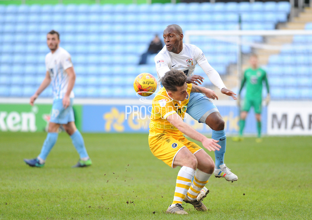 Kyel Reid of Coventry City (11) with Ben Thapmson of Millwall (8) during the EFL Sky Bet League 1 match between Coventry City and Millwall at the Ricoh Arena, Coventry, England on 4 February 2017. Photo by Andy Handley.