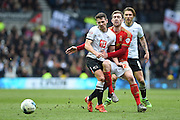 Derby County midfielder Craig Bryson clashes with Nottingham Forest midfielder Gary Gardner during the Sky Bet Championship match between Derby County and Nottingham Forest at the iPro Stadium, Derby, England on 19 March 2016. Photo by Jon Hobley.