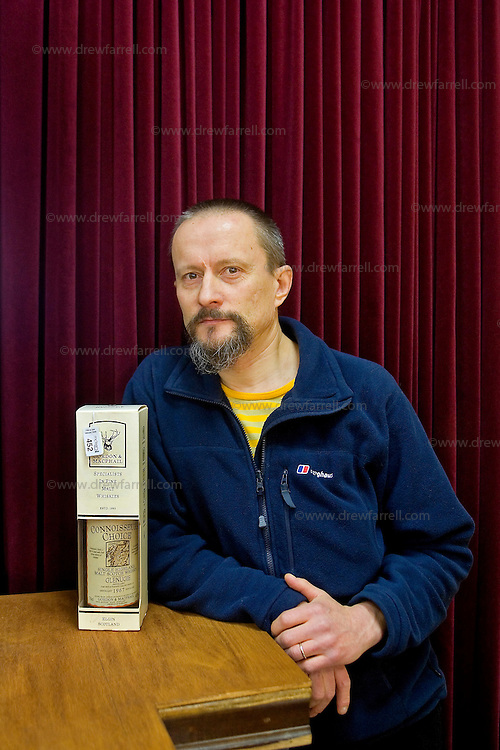 Picture shows : Finnish Fine Art photographer Esko Mannikko pictured with pre auction choice (Lot 452 Glenugie 1967)..Fine & Rare Whisky & Port Auction. Spring 2009. McTears Auctioneers, Glasgow. .Wednesday 25th February 2009..Re Ingvild Paulsen Feature..Picture Drew Farrell..Tel : 07721-735041.....