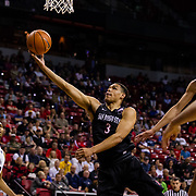 09 March 2018: San Diego State men's basketball takes on Nevada in the quarterfinal round of the Mountain West Conference Tournament. San Diego State Aztecs guard Trey Kell (3) goes up for a lay up while being defended by a Nevada player in the first half. The Aztecs cruise past the Wolfpack 90-73 to move on to the Championship game tomorrow afternoon at 3pm.<br /> More game action at www.sdsuaztecphotos.com