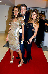 Left to right, ANDREA DELLAL, MARIO TESTINO and CHARLOTTE DELLAL at a party to celebrate the 90th birthday of Vogue magazine held at The Serpentine Gallery, Kensington Gardens, London on 8th November 2006.<br />