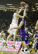 January 12 2010: Iowa Hawkeyes forward Andrew Brommer (20) puts up a shot as Northwestern Wildcats center Luka Mirkovic (12) defends during the first half of an NCAA college basketball game at Carver-Hawkeye Arena in Iowa City, Iowa on January 12, 2010. Northwestern defeated Iowa 90-71.