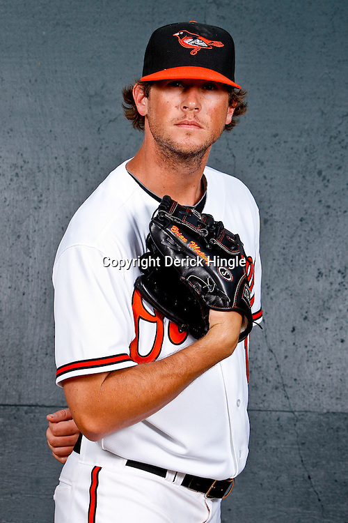 February 26, 2011; Sarasota, FL, USA; Baltimore Orioles starting pitcher Brian Matusz (17) poses during photo day at Ed Smith Stadium.  Mandatory Credit: Derick E. Hingle