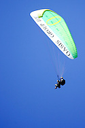 Camps Bay, A Paraglider comes in to land on the beach during the Oasis SKW Camps Bay Beach Touch Rugby Tournament held on the 2 February 2008, Cape Town, South Africa...Image © Sportzpics