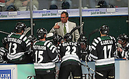 Roughriders head coach Mark Carlson talks to his team during a timeout in their game at the Cedar Rapids Ice Arena in Cedar Rapids on Saturday, September 28, 2013.