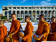 01 JANUARY 2019 - BANGKOK, THAILAND:   Buddhist novices and monks finish the New Year's merit making ceremony on the plaza in front of City Hall in Bangkok. City Hall traditionally hosts one of the largest New Year merit making ceremonies in Thailand. This year about 160 monks participated in the event.    PHOTO BY JACK KURTZ