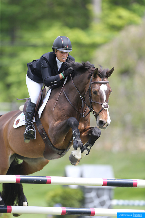 Beezie Madden riding Vanilla in action during the $35,000 Grand Prix of North Salem presented by Karina Brez Jewelry during the Old Salem Farm Spring Horse Show, North Salem, New York, USA. 15th May 2015. Photo Tim Clayton