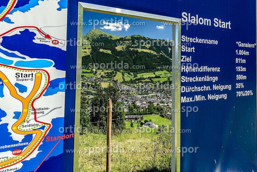 THEMENBILD - Der Blick vom Slalom Start in den Ganslernhang mit dem Zielgelände umgeben mit dem Bergpanorama des Kitzbüheler Horns und der Stadt Kitzbühel, aufgenommen am 26. Juni 2017, Kitzbühel, Österreich // The view from the slalom start into the Ganslernhang with the target area surrounded with the mountain panorama of the Kitzbüheler Horn and the city Kitzbühel at the Streif, Kitzbühel, Austria on 2017/06/26. EXPA Pictures © 2017, PhotoCredit: EXPA/ Stefan Adelsberger
