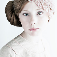 Close up of young girl with lace headwear