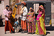Indian family three generations with pregnant young wife by auto rickshaw in Sadri town in Pali District of Rajasthan, Western India